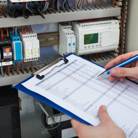 an electrician carrying out an Electrical Installation Condition Report