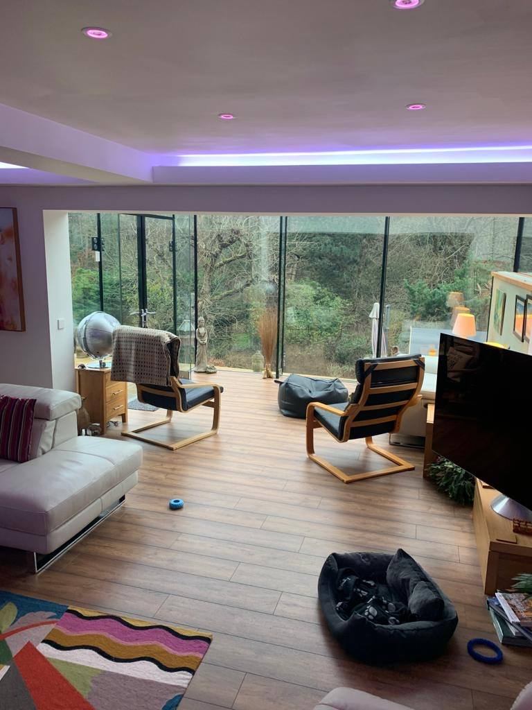 A nice living room with newly installed LED lights.
