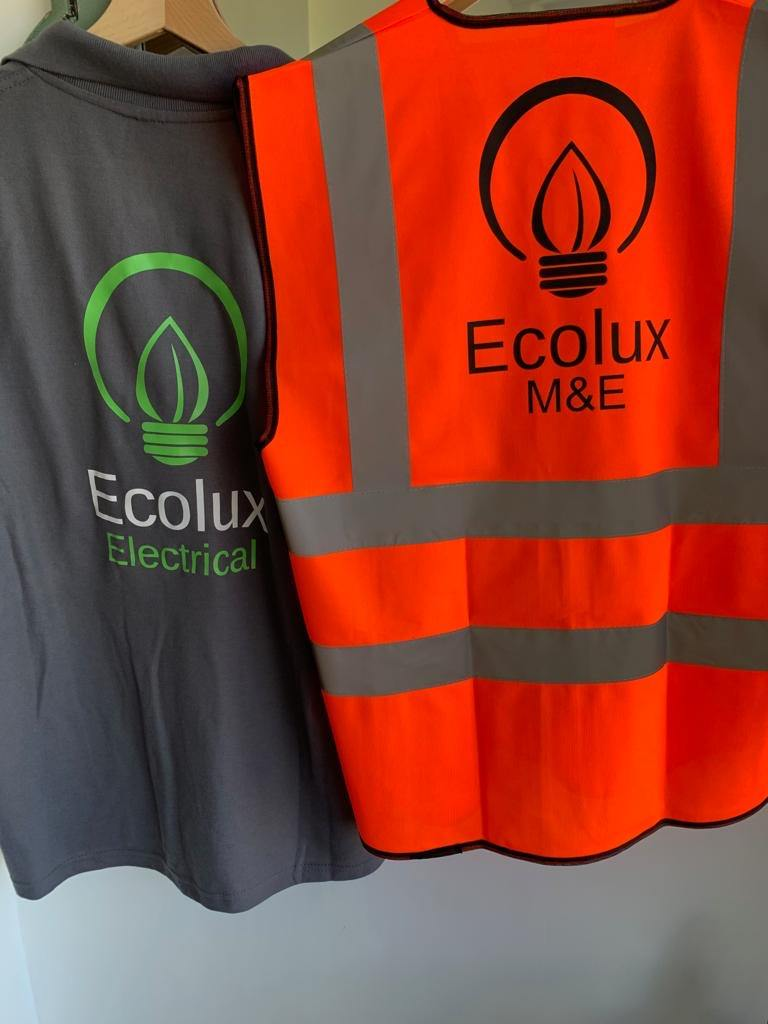 A branded hi-vis safety vest and polo shirt